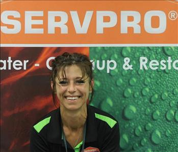 woman in black SERVPRO shirt and hair pulled back