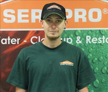 younger guy in a green SERVPRO shirt
