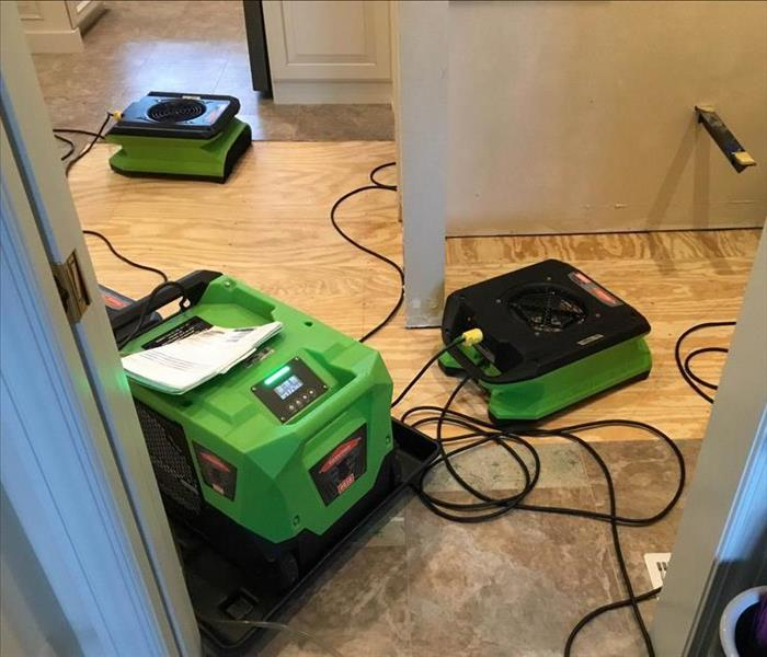 Three green air movers
