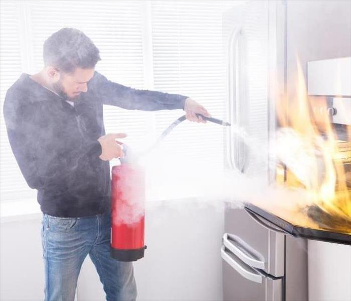 Man using fire extinguisher.
